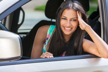 woman driving car: Beautiful Indian Asian young woman girl female driving a car