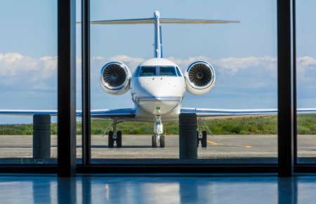 aircraft aeroplane: Private corporate jet airplane or aeroplane parked at an airport