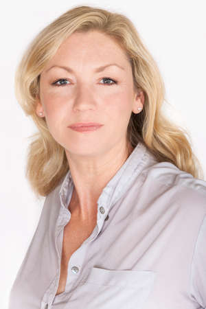 forties: Studio portrait headshot of attractive happy middle aged blond woman in her forties