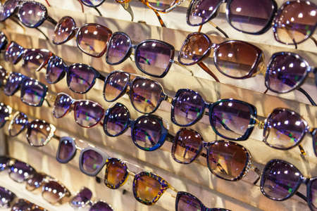 sale shop: Sunglasses for sale in shop or market