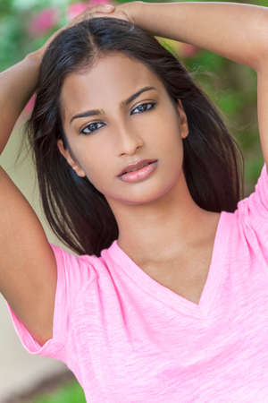 outdoor outside: Outdoor portrait of a beautiful Indian Asian young woman or girl outside in summer sunshine