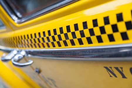 door handles: Close up background photogaph of the side of New York City Yellow Taxi Cab