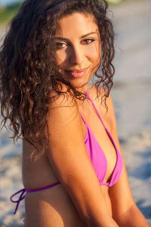 Beautiful young mixed race sexy Hispanic woman in bikini on a deserted tropical beach
