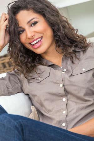 hispanic woman: Beautiful young Latina Hispanic woman with perfect teeth laughing, relaxing at home