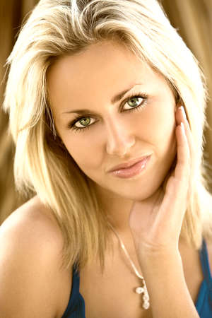 A beautiful blond haired blue eyed model shot with natural light Stock Photo