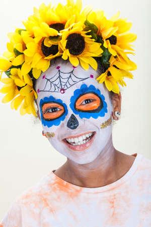 Happy girl in Dia de los Muertos, Day of the Dead skull Halloween make up