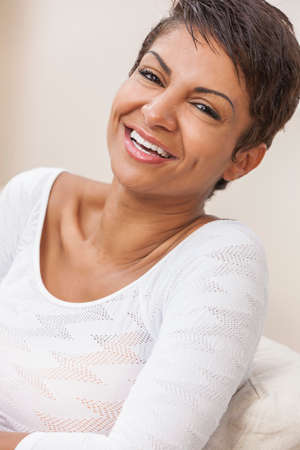 perfect teeth: Happy smiling middle aged African American woman couple with perfect teeth