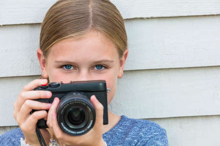 camera girl: Girl child taking picture with a camera