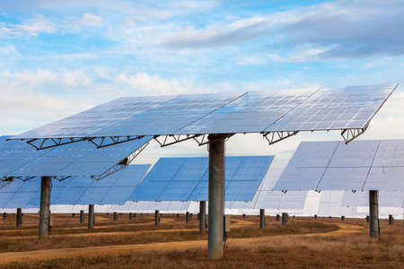 A field of solar mirror panels harnessing the suns rays to provide alternative green energy Stock Photo