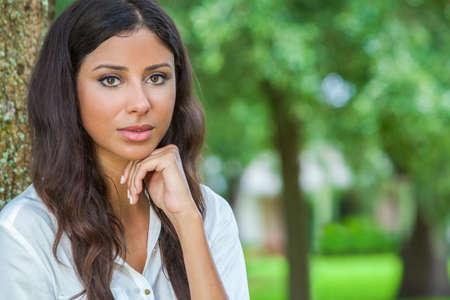 sexy latina: Outdoor portrait of a beautiful thoughtful young female Latina Hispanic woman