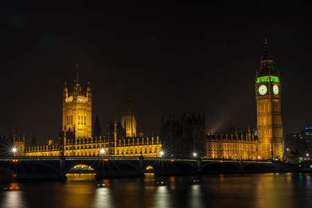 The Houses of Parliament, Big Ben and Westminster Bridge over the River Thames, London, England at Night