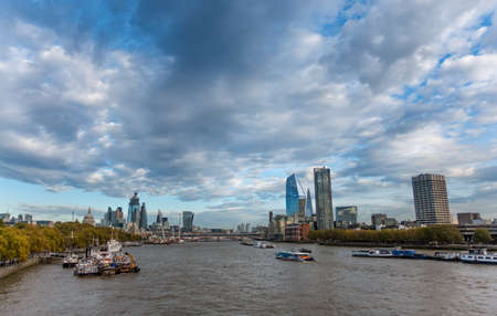 View along the River Thames from  Bridge towards the City of London skyline including The Shard and St Pals Cathedral