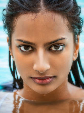 Portrait of beautiful sexy young Indian Asian woman or girl wearing bikini in swimming pool Stock fotó