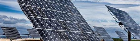 HDR panoramic web banner photovoltaic solar panels providing alternative green energy Stock Photo