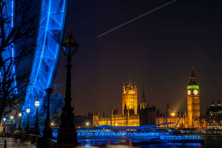 Long exposure of Big Ben, Houses of Parliament, Westminster Bridge, London Eye at Night, London England
