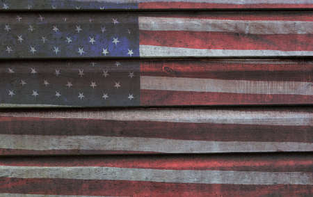 Photomerged background of American flag, USA stars and stripes, with wooden planks fence or panelling background Foto de archivo