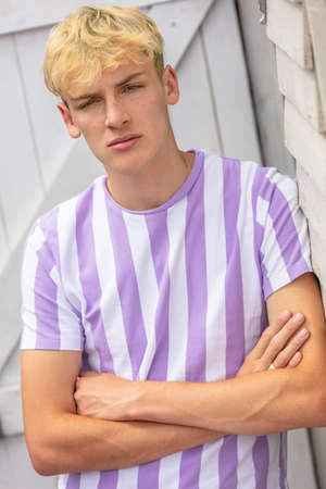 Boy teenager teen blonde male young man outside arms folded and wearing striped t-shirt
