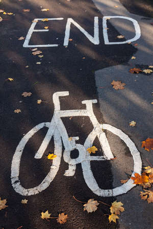 End of bicycle or cycle lane sign painted on a path or pavement
