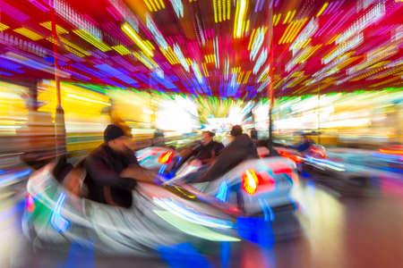 Motion blurred dodgems or bumper cars at a fun fair