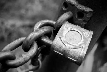 Black and white of a padlock and chain
