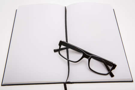 blanc: blanc book with reading glasses Stock Photo