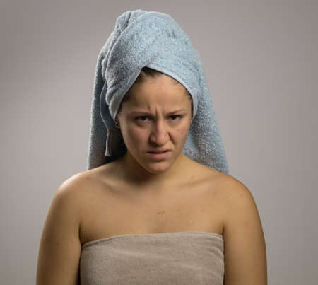 pissed off girl after shower with two towels Stockfoto