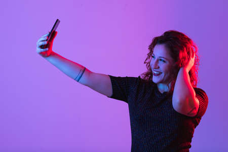 young girl making selfie and having fun Stock Photo
