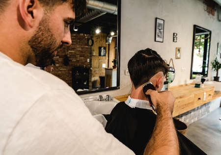 Men Hair Salon. Barber Doing Haircut In Barbershop. Young Male Client And Hairdresser. Stok Fotoğraf