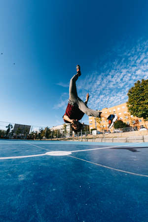 extreme sport, parkour or breakdance and people concept - young man jumping high Stock fotó