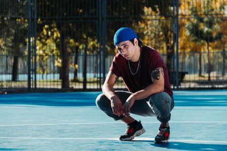 Young cool man break dancer standing in park. Tattoo on body 免版税图像 - 134845610