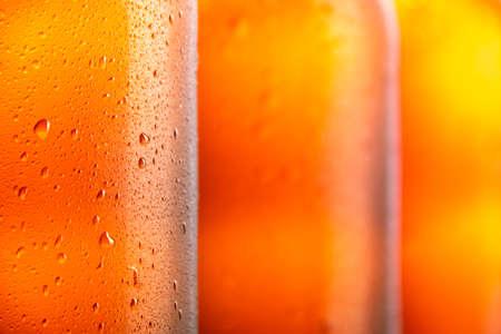 Three fresh beer bottle for background