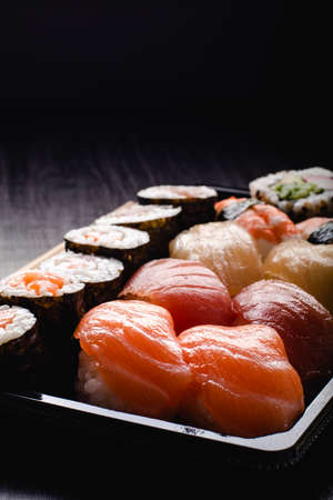 Sushi to go concept. Takeaway box with sushi