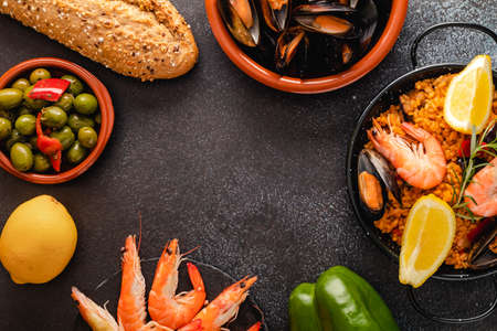 Vegetable paella with seafood, top view and copy space Standard-Bild