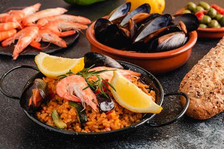 Paella traditional Spanish food, served on tapa plate