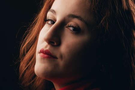 Glamor woman dark portrait, beautiful female looking to camera Standard-Bild