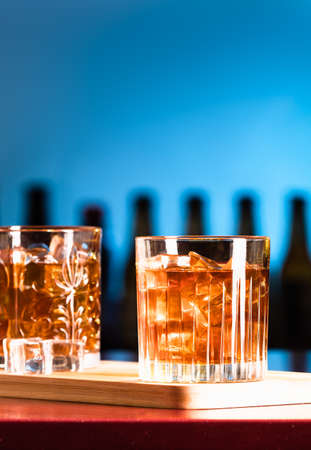 Whiskey glasses with ice in a lounge bar Standard-Bild
