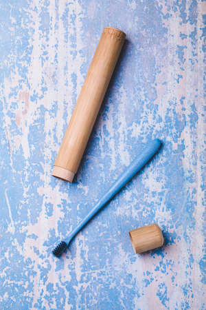 Bamboo toothbrush on blue wood background. Concept eco friendly Standard-Bild