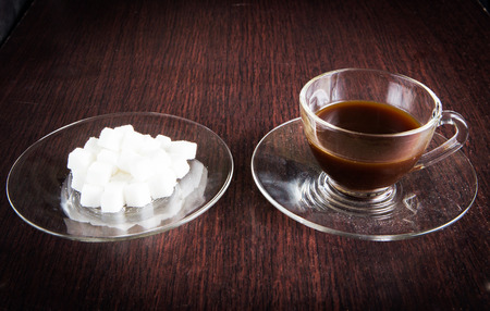 sugar cube: a cup of coffee and a plate of sugar cube Stock Photo