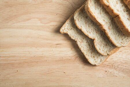 wood block: many bread slice on the wood block Stock Photo