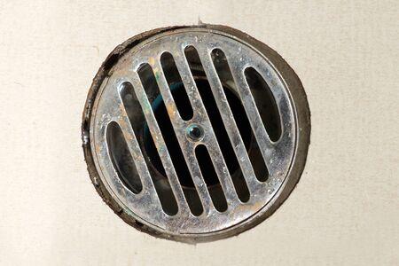 close up drain filter on a bath room floor