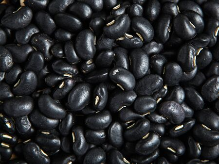 protein crops: close up pile of black beans as a background Stock Photo