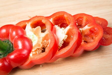 sliced red sweet pepper on a wooden block Stock Photo