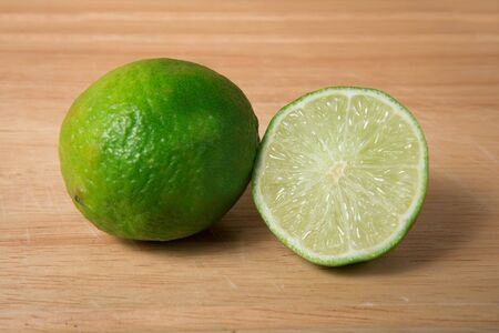green lime on a wooden background