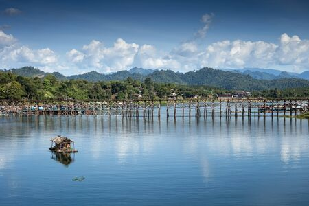 landscape view of great lagoon with a wooden bridge with a small raft on a great lagoon.   Stock Photo