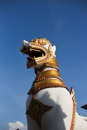 Myanmar country lion statue on a blue sky background Stock Photo
