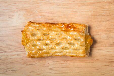 sweet corn pie on a wooden block