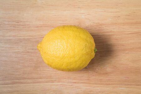 lemon fruit on a wooden block Stock Photo