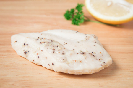 steamed chicken breast on a wooden block.(Selcetive focus)