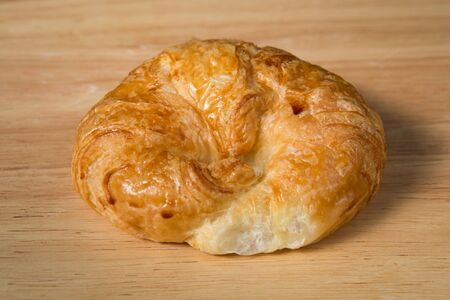 butter croissant   on a wooden block Stock Photo
