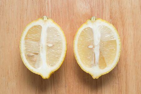 sliced lemon fruit on a wooden block Stock Photo